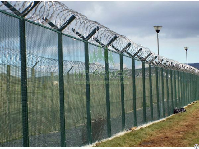 High Security Fence With Razor And Barbed Wire